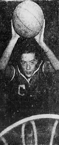 Image taken from above basket of Anna Belle Cole, girls basketball player for Clayton High School, North CArolina, with ball about to throw into basket. From The News and Observer, Raleigh, North Carolina, February 6, 1952.