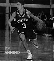 Picture of boys basketball player, Joe Annino Jr. of the Maloney High School (Connecticut) team, dribbling to his right in his dark SPARTANS number 3 uniform. From The Hartford Courant, Hartford, Conn., February 12, 1997, photograph by Marc Yves Regis.