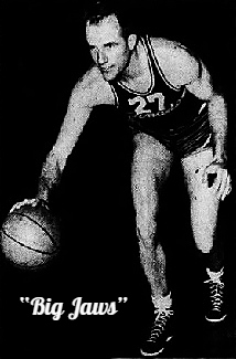 Image of number 27, John (Big Jaws) Toomay, basketball player for the Far Eastern Air Force Tornados based in Japan. Shown crouched and dribbling the ball in uniform #27, from The Pomona Progress Bullein, Pomona, California, March 24, 1951.