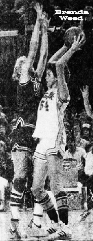 Image of Brenda Weed, Iowa girls basketball player for the Norwalk High School Warriorettes team. Shown tall with  ball overhead, looking to pass to theleft, in #54 uniform, against Lake View-Auburn, in the State AAA semifinal contest on 3/13/1981. Weed scorred 44 pts. in a 73-70 victory. From The Des Moines Tribune. Des Moines, Iowa, 3/14/1981. Photo by Bob Modersohn.