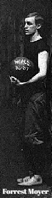 Image of boys basketball player, Forrest Moyer, Washington High School (Indiana). Holding basketball, standing, facing left. Cropped from 1906-07 team photo, from the Basketball History of Washington High School, by Larry Stagen.