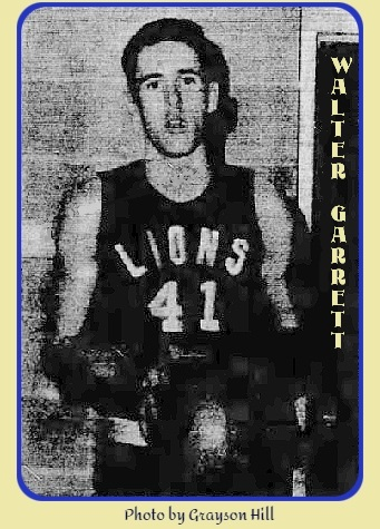 Image of boys basketball player, Walter Garrett, West End High School (Birmingham, Alabama), in LIONS uniform #41, holding basketball in front of his stomach. From the Daily Northwest Alabamian, January 18, 1963. Photo by Grayson Hill.
