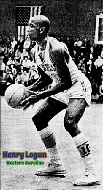 Image of boys basketball player, Henry Logan, Western CArolina University, side view, knees bent, about to shoot to our left. From the Asheville Citizen-Times, Asheville, North Carolina, February 16, 2003. Photo by June Glenn Jr.
