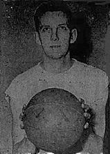 Image from chest up of basketball player Harry Klomp, holding a bsketball. From the Paterson Evening News, http://luckyshow.org/basketball/pics/Newest%203/Klomp.jpgaterson, New Jersy, February 12, 1948.