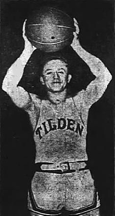 Image of boys basketball player, Wally Piekarski, Tilden Tech Junior High (Illinois), holding ball above his head. From The Crete News, Crete, Nebraska, March 18, 1948.