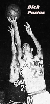 Image of  men's basketball player, Tampa University's Dick Pusins, number 24, up in the air fighting for a rebound against Jim Hayes of Florida Southern in a 2/8/1966 game. From The Tampa Tribune, February 9, 1966. Photographer Jerome Sierra Jr.