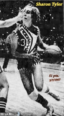 Image of Iowa girls basketball player, Sharon TTyler, driving with the ball with a Fredericksburg defender's hand in her face. In #3 uniform in the 3/7/1967 playoff game where she scored 51 points. From The Des Moines Register, March 8, 1967.
