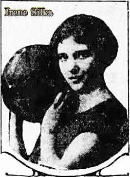 Portrait with left shoulder in foreground, holding basketball up near face, of Irene Silka, girls basketball player for Maynard High School, Iowa. From The Des Moines Register, March 23, 1926.