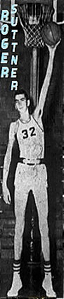 Picture of seven-foot boys basketball player, Roger Suttner, Ridgway High School, Illinois. Shown facing camera reaching high with left hand to hold basketball up by the basket. Wearing number 32. From the Paducah Sun-Democrat, Paducah, Kentucky, November 13, 1958.
