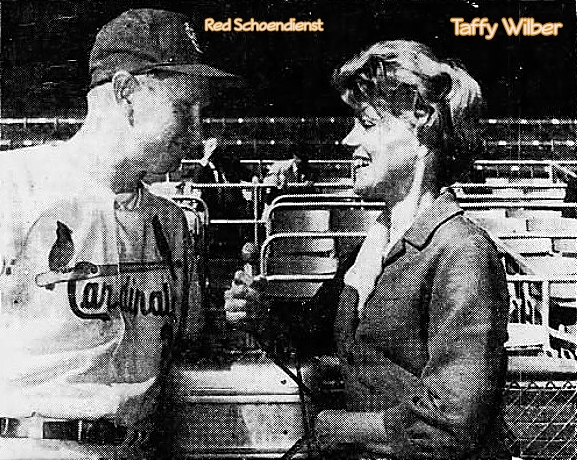 AP photo of early woman baseball reporter (radio show at KMOX, St. Louis, for four years as of 1965. Interviewing then St. Louis Cardinals manager, Red Schoendienst. From The El Paso Times, El Paso, Texas, February 18, 1965.