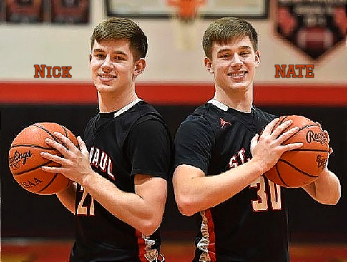 The Winslow Brothers, shown back to back, each with basketballs. In dark uniforms, Nick on the left, number 21, NAte (r.) number 30. From the March 2, 2021 Norwalk Reflector, Norwalk, OHio. Photographer: Erin Caldwell., .