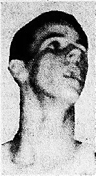 Portrait of Alabama boys basketball player James Booth, Eufaula High School Tigers, looking up to our right. From The Dothan Eagle, Dothan, Alabama, February 21, 1960.