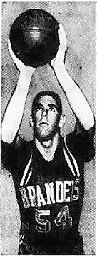 Image of Brandeis University basketball player Brian Hollander, shown in uniform #54, with ball in both hands over his head. From The Boston Globe, Boston, Massachusetts, February 23, 1961.