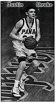 Illinois basketball player Justin Shrake in his Pana High School unifrm, charging upcourt. From th Herald and Review, Decatur, Illinois, January 4, s001. Photo by Dennis Magee.