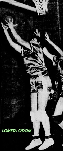 Photo of Lometa Odom, girls basketball player for Dimmitt High Scjool (Texas) up in the air, under the basket, facung our left, shooting the ball backwards over her head, looking for two of her 78 points in the March 14, 1952 basketball game against Penelope High. From The Waco News-Tribune, Waco, Texas, March 15, 1952. Photo by jimmie Willis.