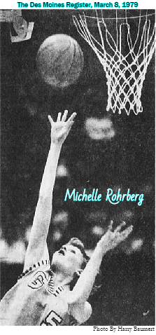 Image from The Des Moines Register, Des Moines, Iowa. March 8, 1979, captioned 'Glenwood's Michelle Rohrberg hits two of 57 points. The photo by Harry Baumert, shows Rohrberg looking up , under the basket, following the release of her shot. She wears uniform number 5. The 5 and a G are large white above a colored uniform with parallel black and white stripes around the cut off sleeve and neck area. We see the ball up alongside the basket.