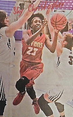 Image of Shy Christopher going up for a shot in her red, number 23 uniform, for the Jacksonville High School team in Arkansas. Photo by David Scolli, Arkansas Leader.